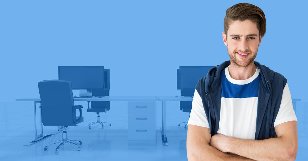 Portrait of confident man standing with arms crossed in the office