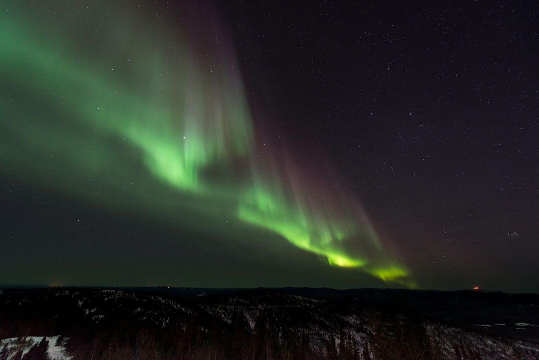 Green Northern Lights in Black Sky