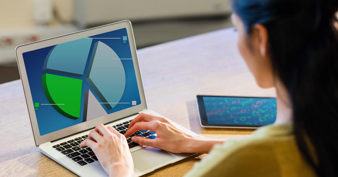 Woman working on a laptop with barcharts and statistics