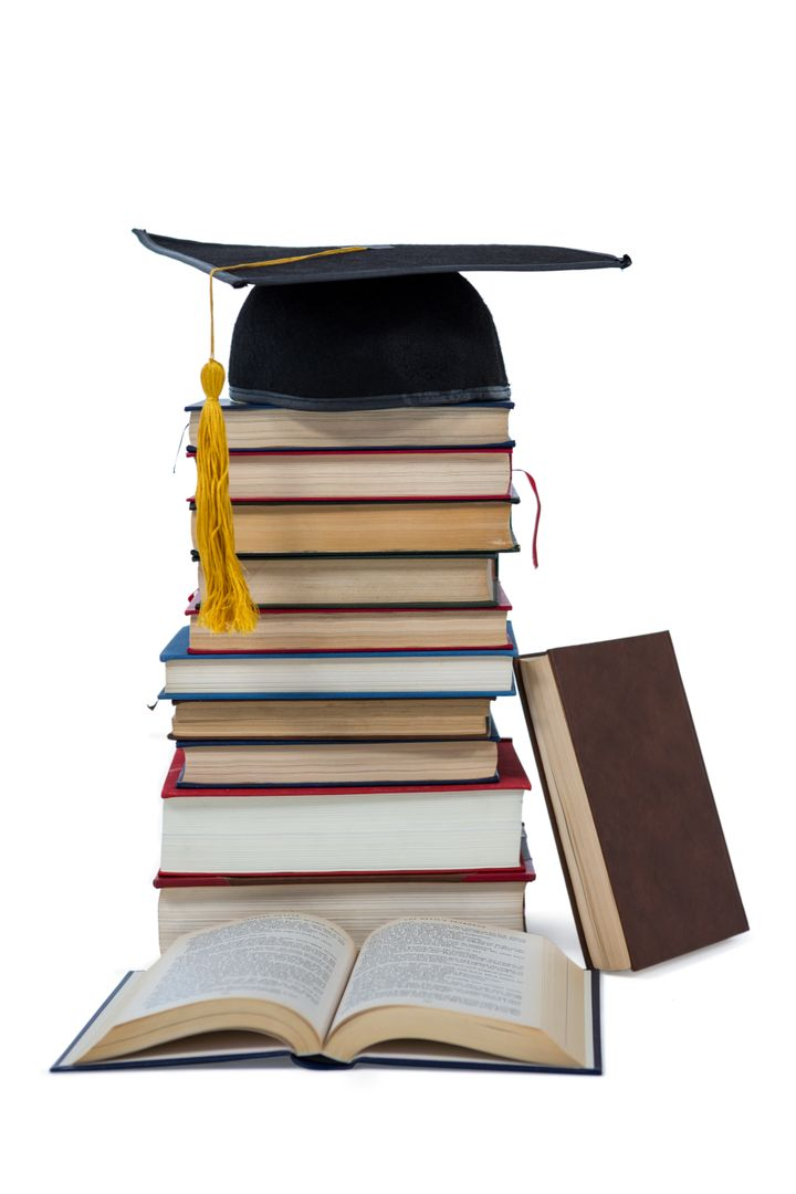 Mortarboard on stack of books on white background Free Stock Images from PikWizard