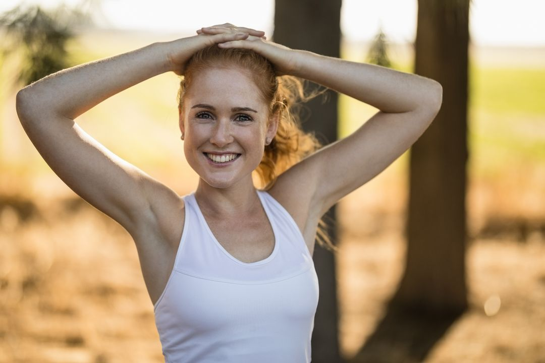 Portrait of smiling young woman exercising on sunny day at farm Free Stock Images from PikWizard