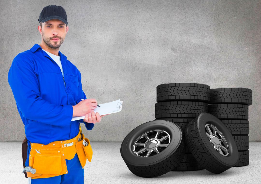 Digital composite image of serviceman writing on clipboard and standing next to tyres Free Stock Images from PikWizard