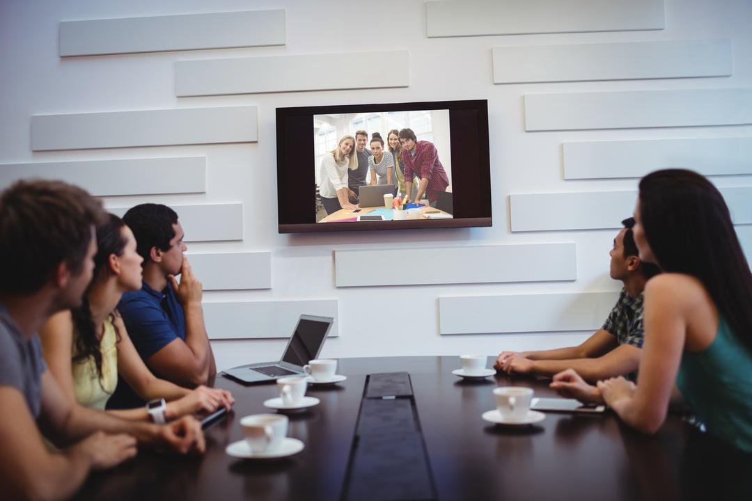 Business executives doing a video conference in the conference room