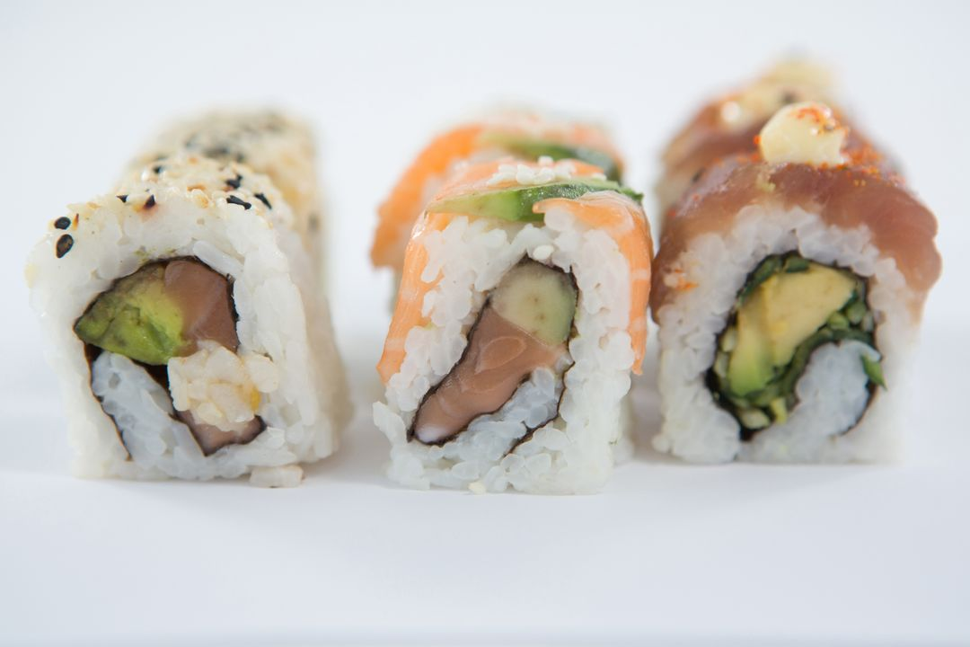 Close-up of uramaki sushi roll on white background Free Stock Images from PikWizard