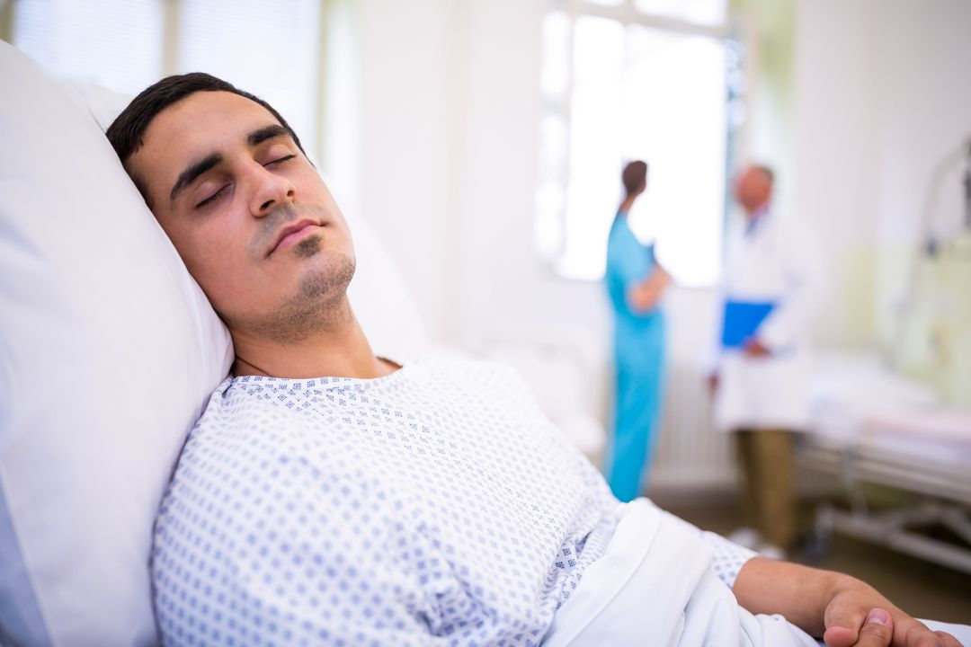 Close-up of patient sleeping on bed in hospital Free Stock Images from PikWizard
