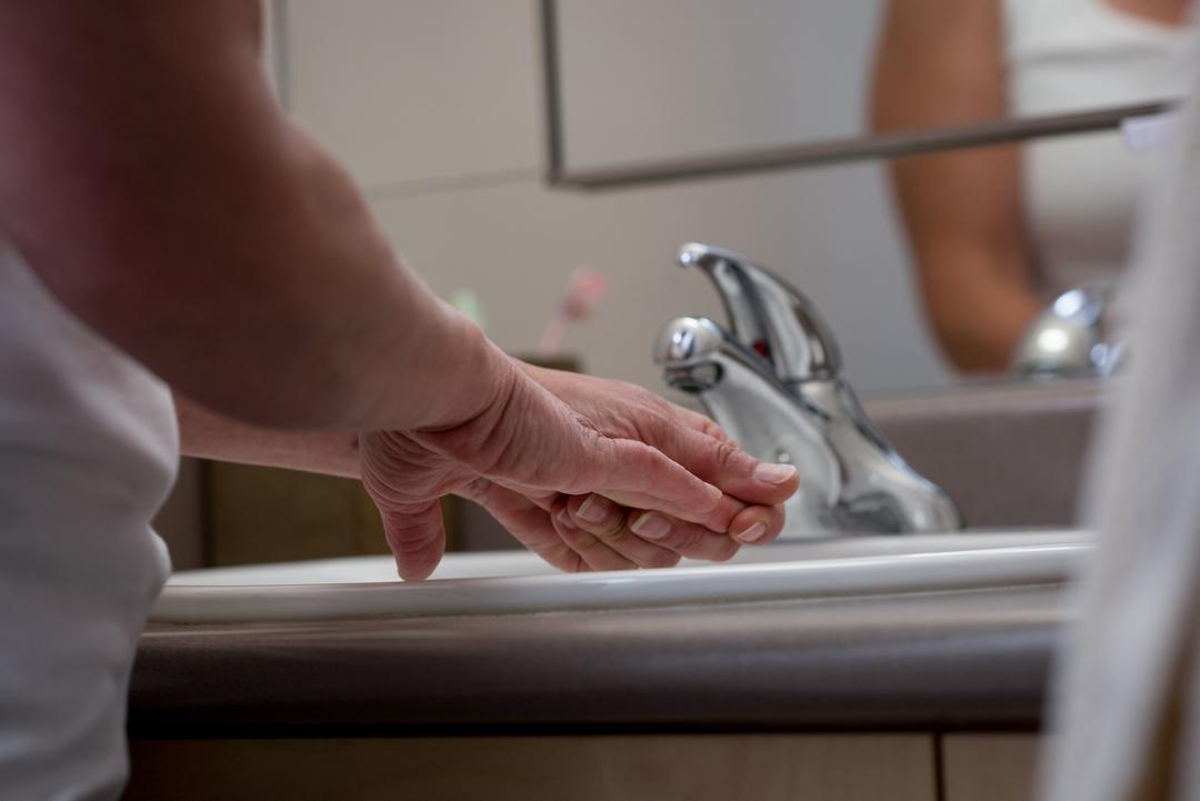 Mid-section of senior woman washing her hands Free Stock Images from PikWizard