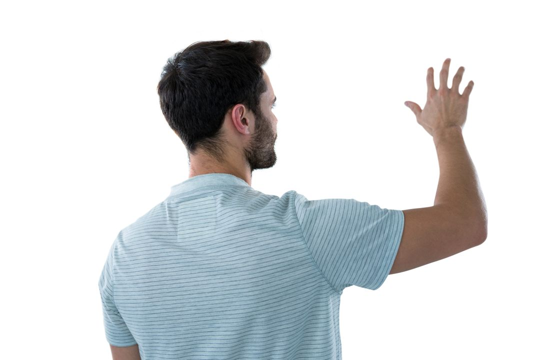 Rear view of man pretending to touch an invisible object Free Stock Images from PikWizard