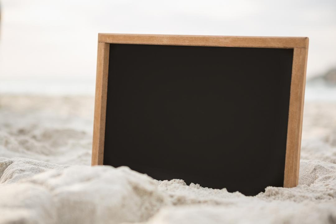 Blank slate in sand at beach