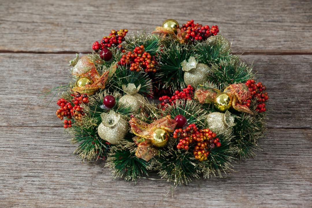 Close-up of christmas wreath on a plank