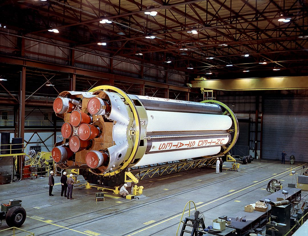 The completely assembled Saturn 1 S-1 stage is being ready for checkout in the Marshall Space Flight Center, building 4705, January 18, 1961. The Saturn I S-I stage had eight H-1 engines clustered, using liquid oxygen/kerosene-1 (LOX/RP-1) propellants capable of producing a total of 1,500,000 pounds of thrust.
