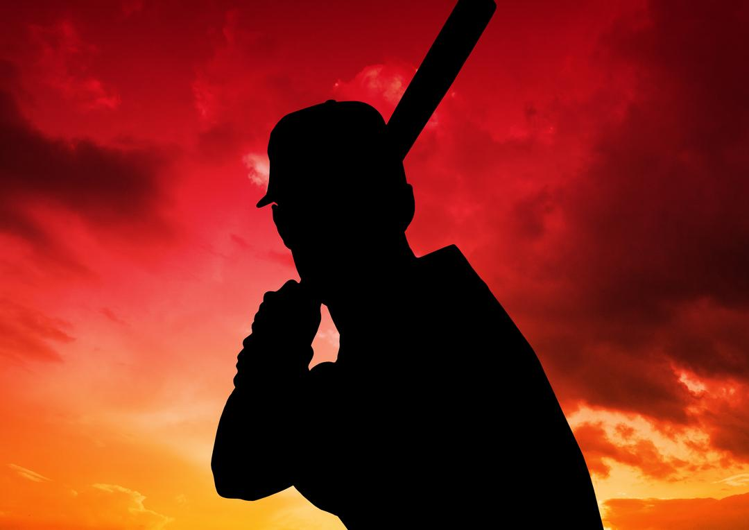 Digital composition of baseball player against colorful sky