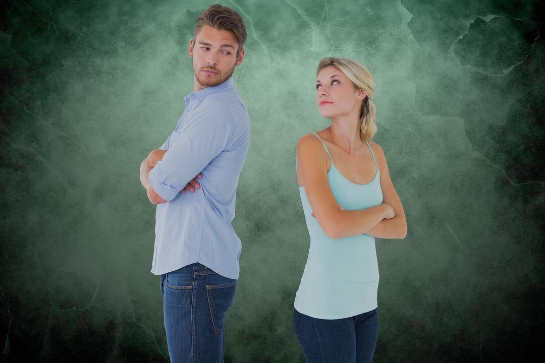 Digital composite of Couple with arms crossed arguing over green background