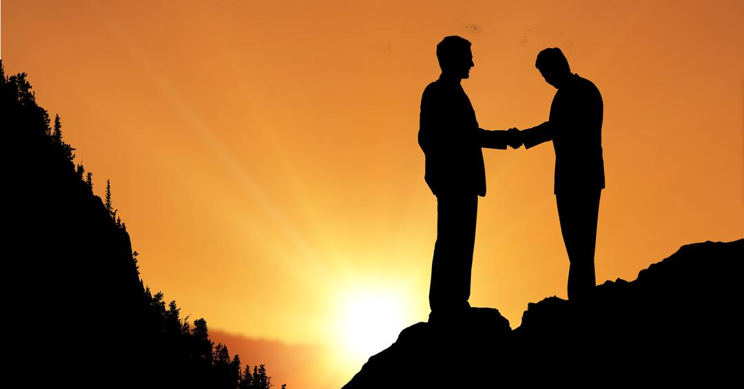 Digital composite of Silhouette businessmen shaking hands during sunset Free Stock Images from PikWizard