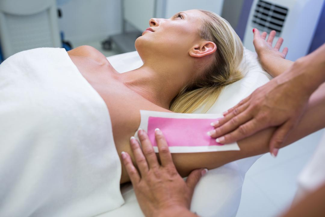 Woman getting her armpit hair removed at beauty salon Free Stock Images from PikWizard