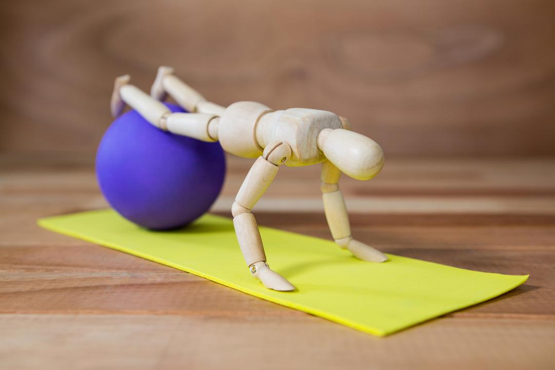 Conceptual image of figurines performing stretching exercise Free Stock Images from PikWizard