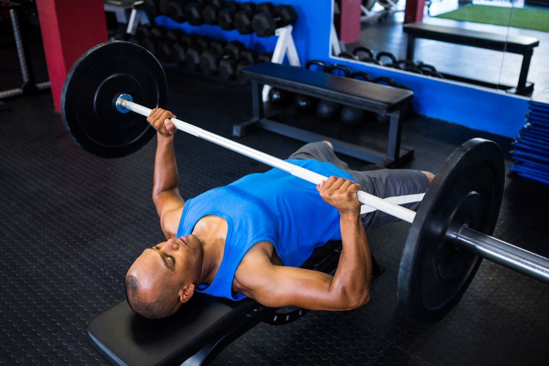 Man doing a bench press at a local gym