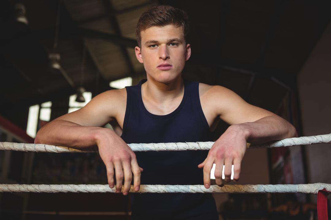 Portrait of boxer standing in boxing ring
