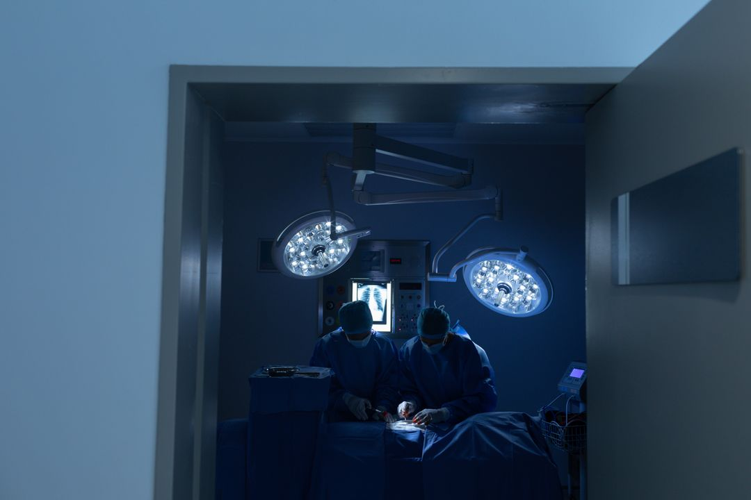 Surgeons performing operation in operation theater at hospital