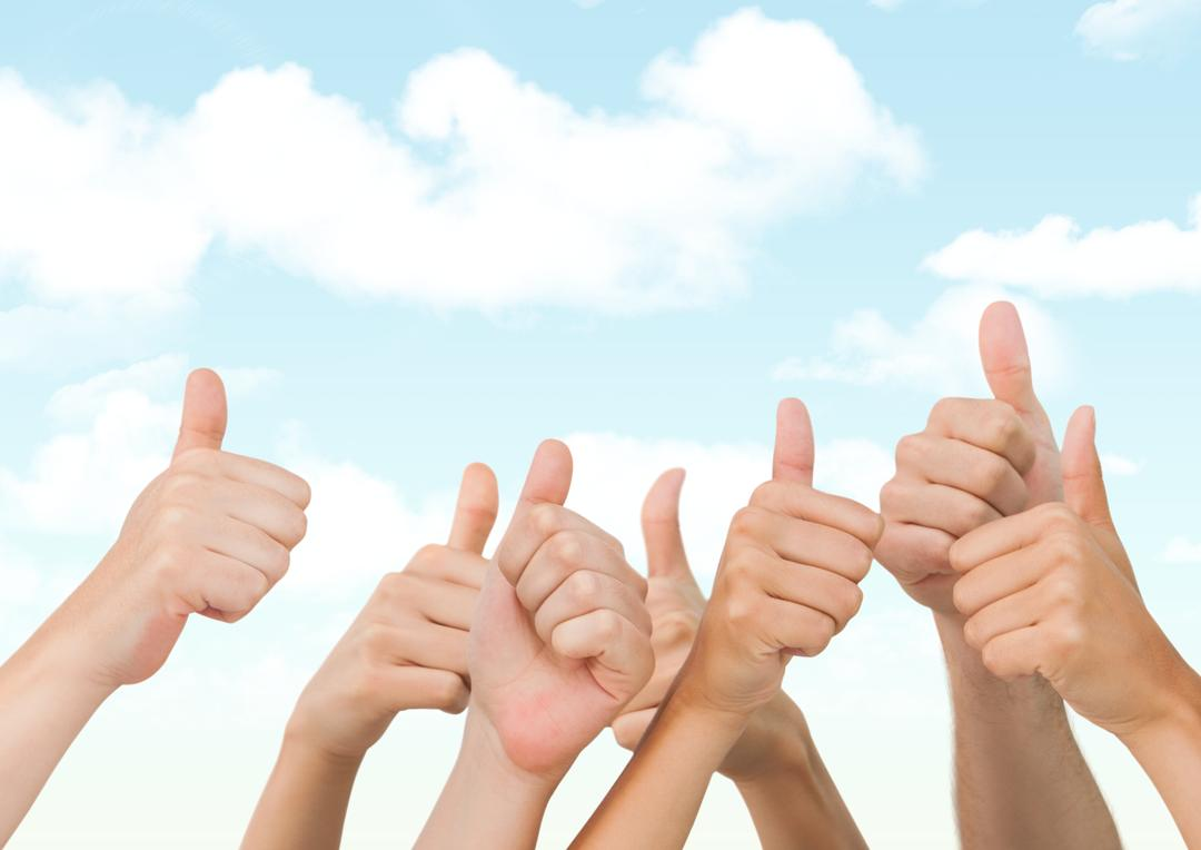 Digital composite of Many hands thumbs up against blue sky