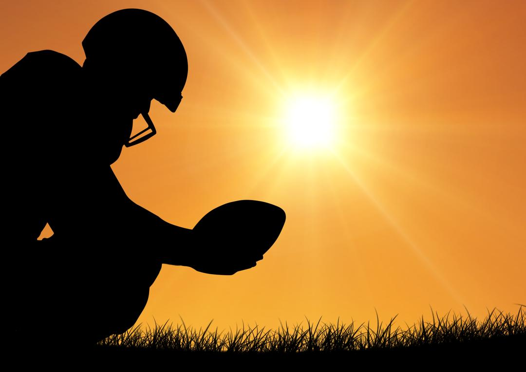 Silhouette of rugby player holding ball against bright sunlight Free Stock Images from PikWizard