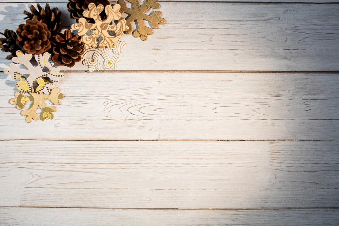 Snowflakes and pine cone on wooden plank during christmas time Free Stock Images from PikWizard