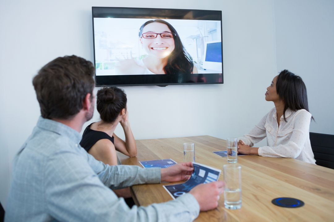 Business colleagues attending a video call in conference room at office