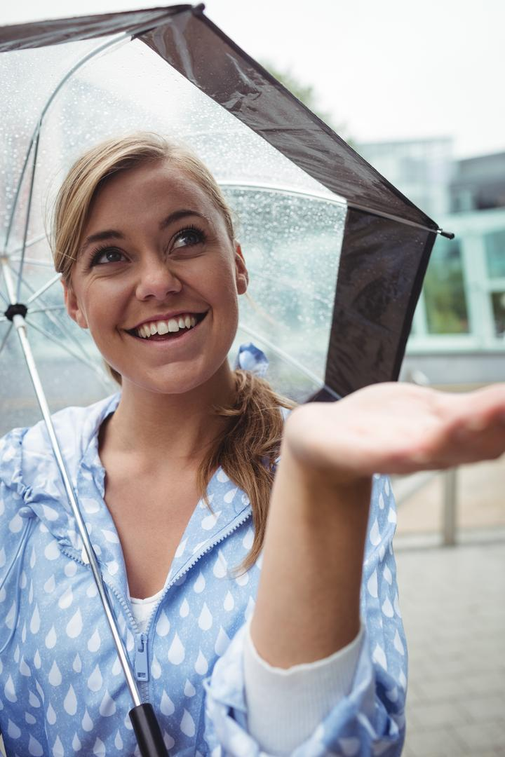 Beautiful woman enjoying rain during rainy season Free Stock Images from PikWizard
