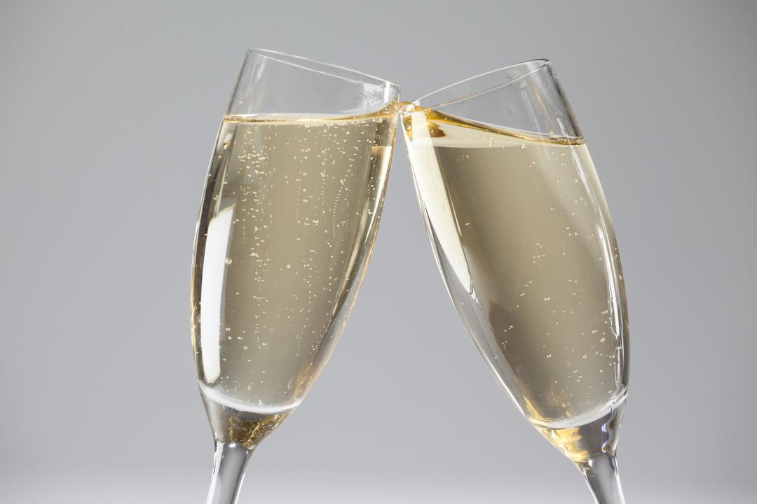 Image of Two Glasses of Champagne Clashing