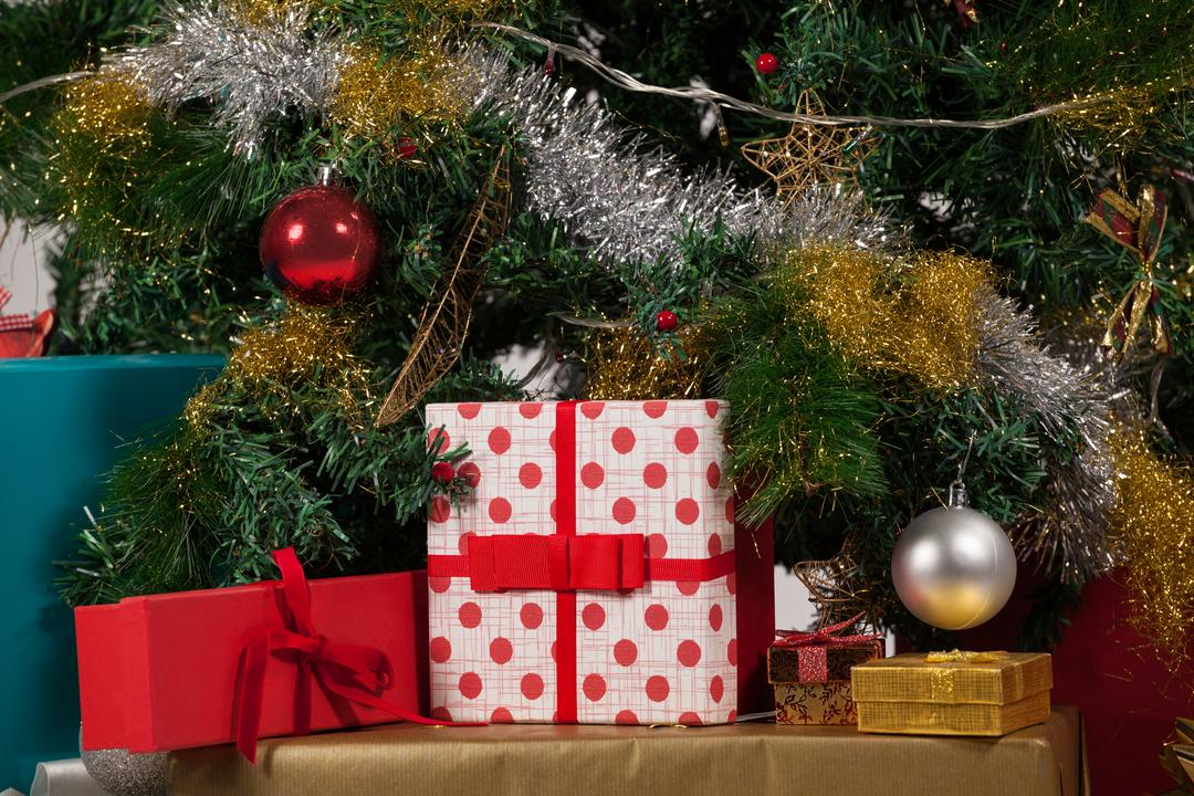 Christmas tree with wrapped presents surrounding it