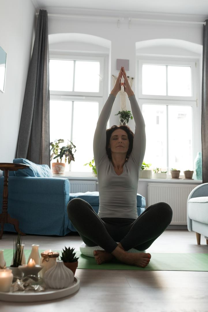 Beautiful woman performing yoga at home