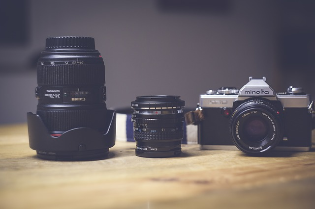 Camera and lenses on wooden table