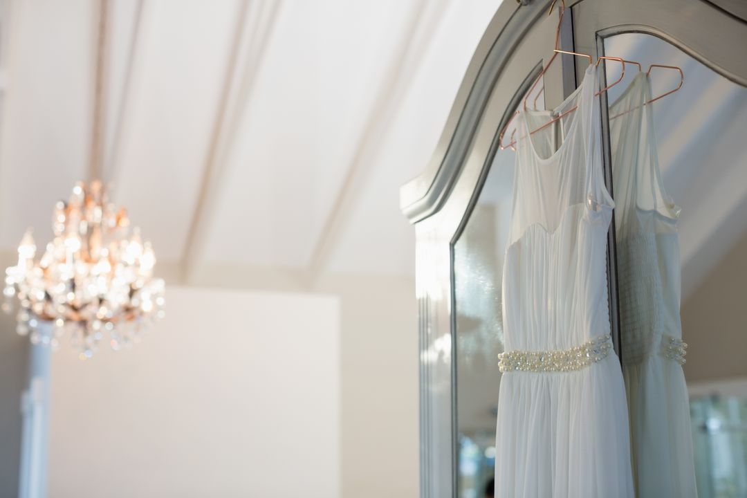Wedding dress hanging in hanger at home Free Stock Images from PikWizard