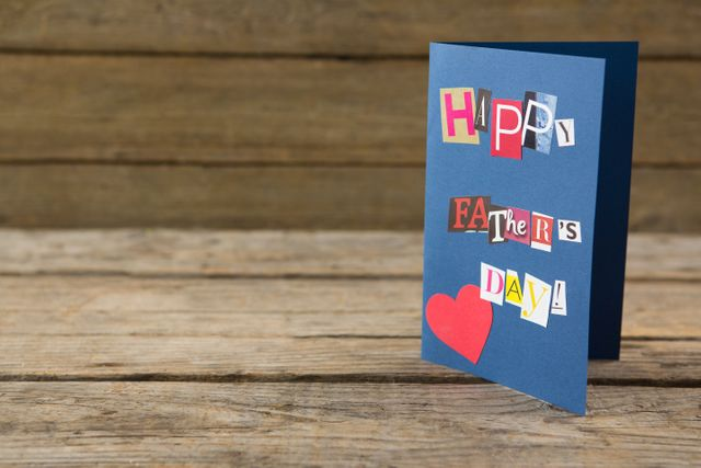 Close up of happy fathers day greeting card on table