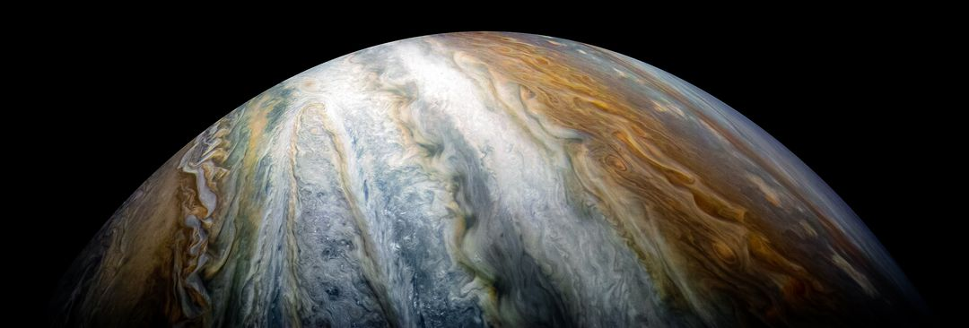 Colorful swirling cloud belts dominate Jupiter's southern hemisphere in this image captured by NASA's Juno spacecraft.  Jupiter appears in this color-enhanced image as a tapestry of vibrant cloud bands and storms. The dark region in the far left is called the South Temperate Belt. Intersecting the belt is a ghost-like feature of slithering white clouds. This is the largest feature in Jupiter's low latitudes that's a cyclone (rotating with clockwise motion).  This image was taken on Dec. 16, 2017 at 10:12 PST (1:12 p.m. EST), as Juno performed its tenth close flyby of Jupiter. At the time the image was taken, the spacecraft was about 8,453 miles (13,604 kilometers) from the tops of the clouds of the planet at a latitude of 27.9 degrees south.  The spatial scale in this image is 5.6 miles/pixel (9.1 kilometers/pixel).  Citizen scientist Kevin M. Gill processed this image using data from the JunoCam imager.  https://photojournal.jpl.nasa.gov/catalog/PIA21974