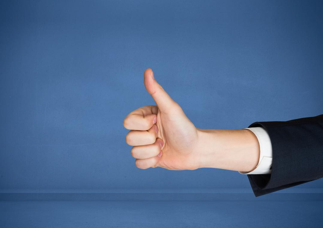 Digital composite of Hand with thumbs up against blue background