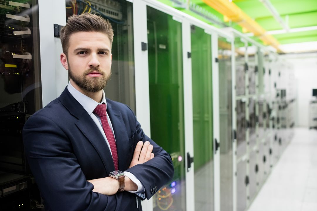 Portrait of technician standing with arms crossed in a server room Free Stock Images from PikWizard