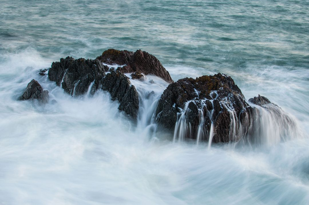 Rocks boulders waves