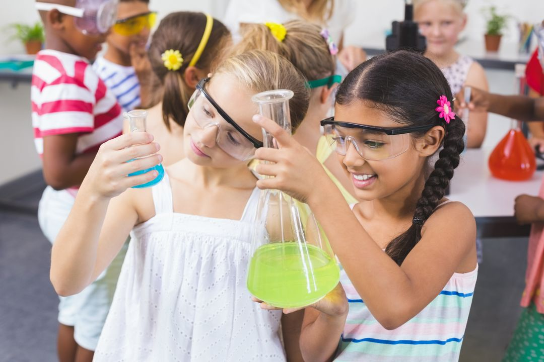 Kids doing a chemical experiment in laboratory at school Free Stock Images from PikWizard