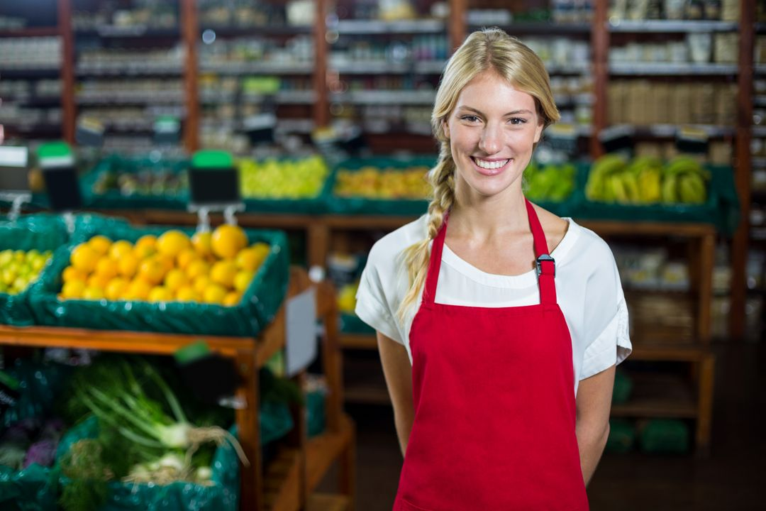 Portrait of smiling female staff standing in organic section of supermarket Free Stock Images from PikWizard