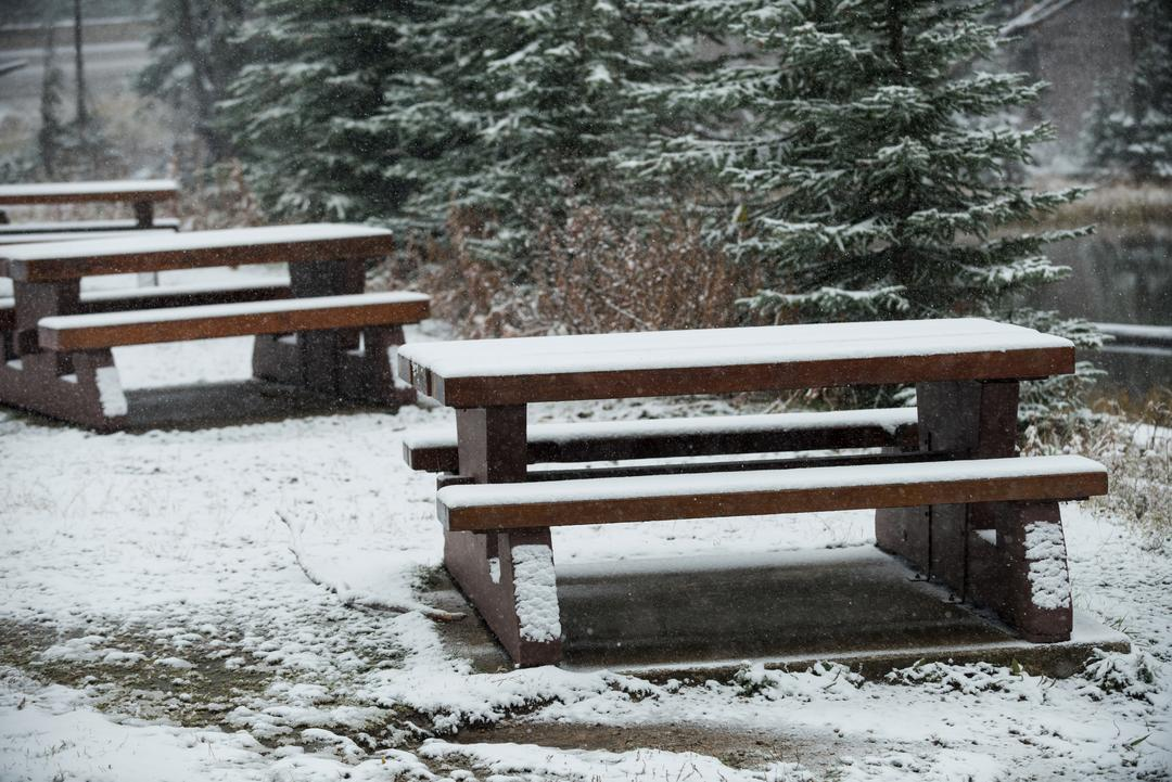 Snow-covered benches beside the lake during winter Free Stock Images from PikWizard