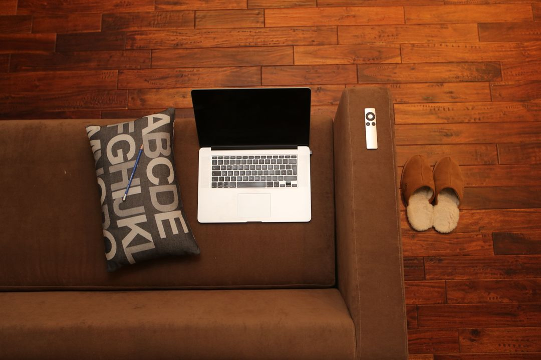 MacBook Pro Wood Couch Cushion Free Photo