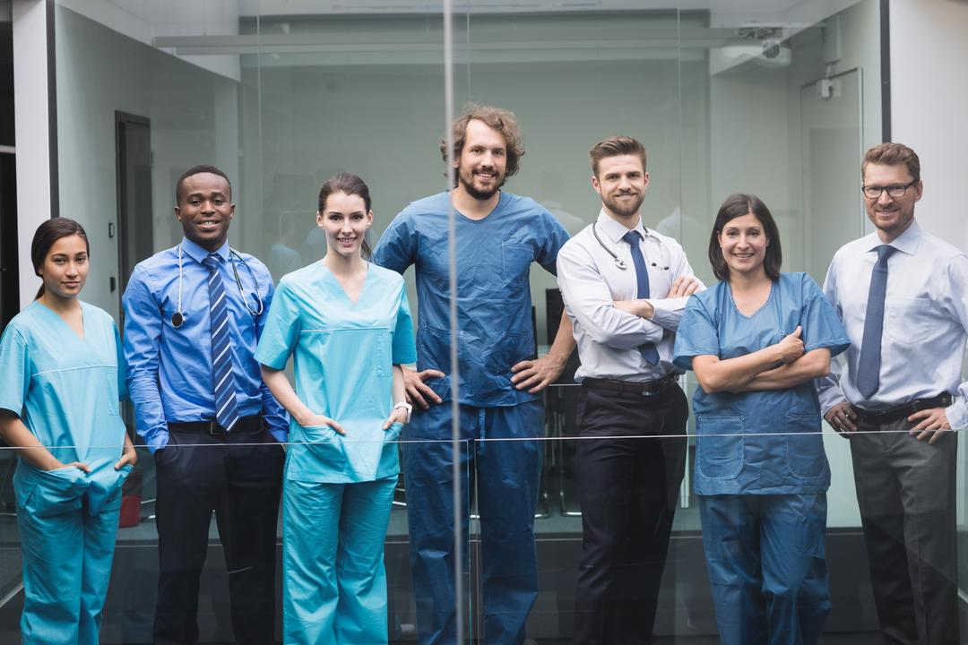 Portrait of smiling doctors standing together in corridor at hospital