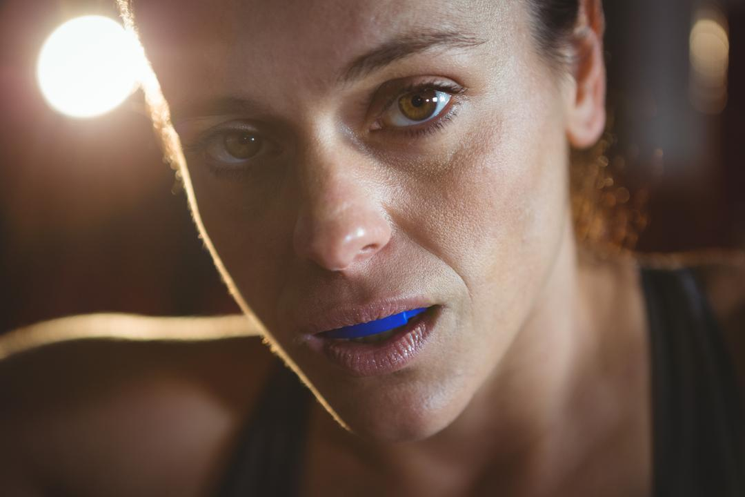 Close-up of confident female boxer in fitness studio