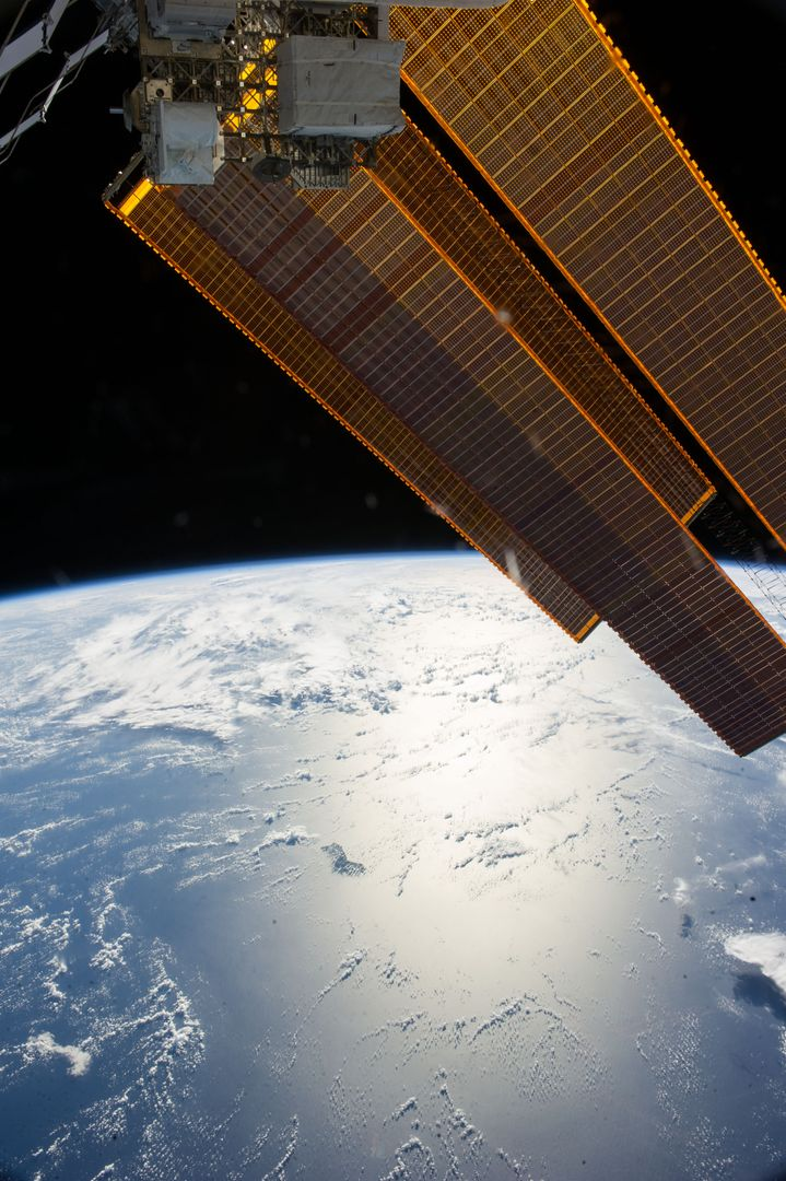 ISS040-E-006252 (30 May 2014) --- Solar array panels and Earth's horizon are featured in this image photographed by an Expedition 40 crew member on the International Space Station.
