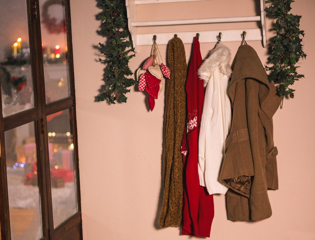 Winter wear hanging on hook hanger on wall at home