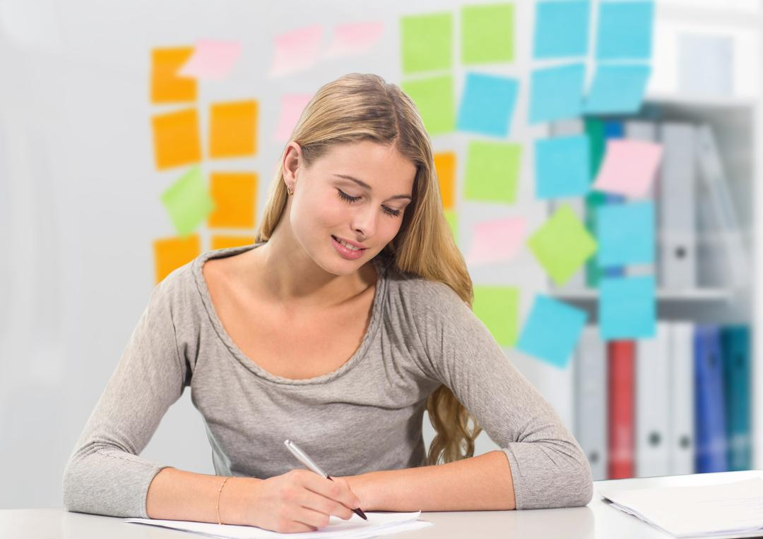 Digital composition of woman writing notes against sticky notes in background