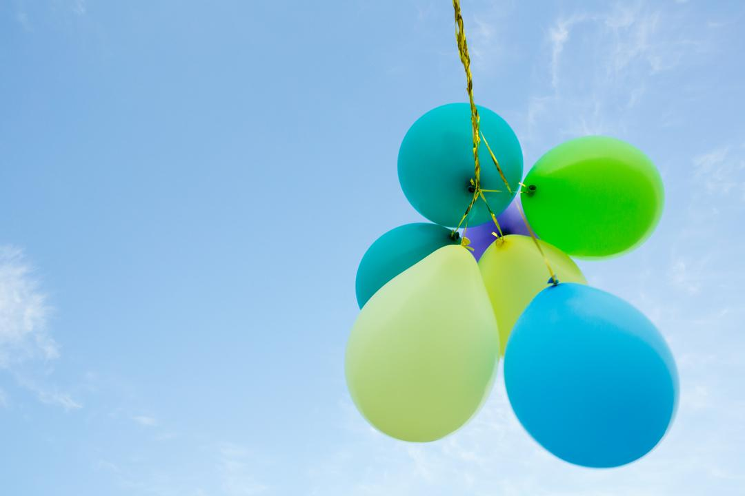 Bunch of pastel color balloons floating in the air against blue sky Free Stock Images from PikWizard