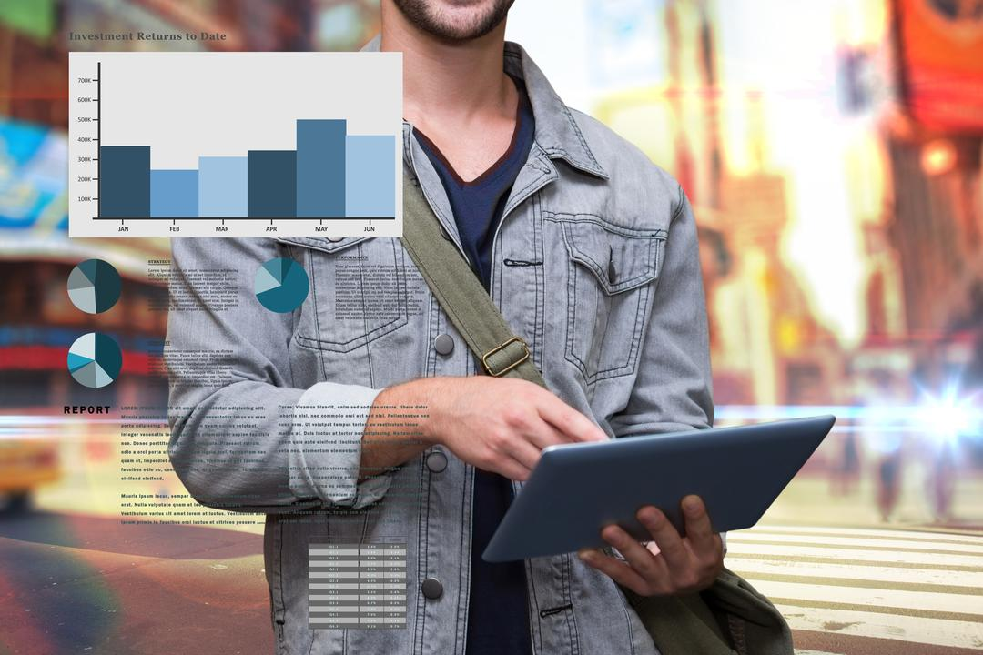 Image of a Man Working on Tablet With Pie Charts and Bar Charts
