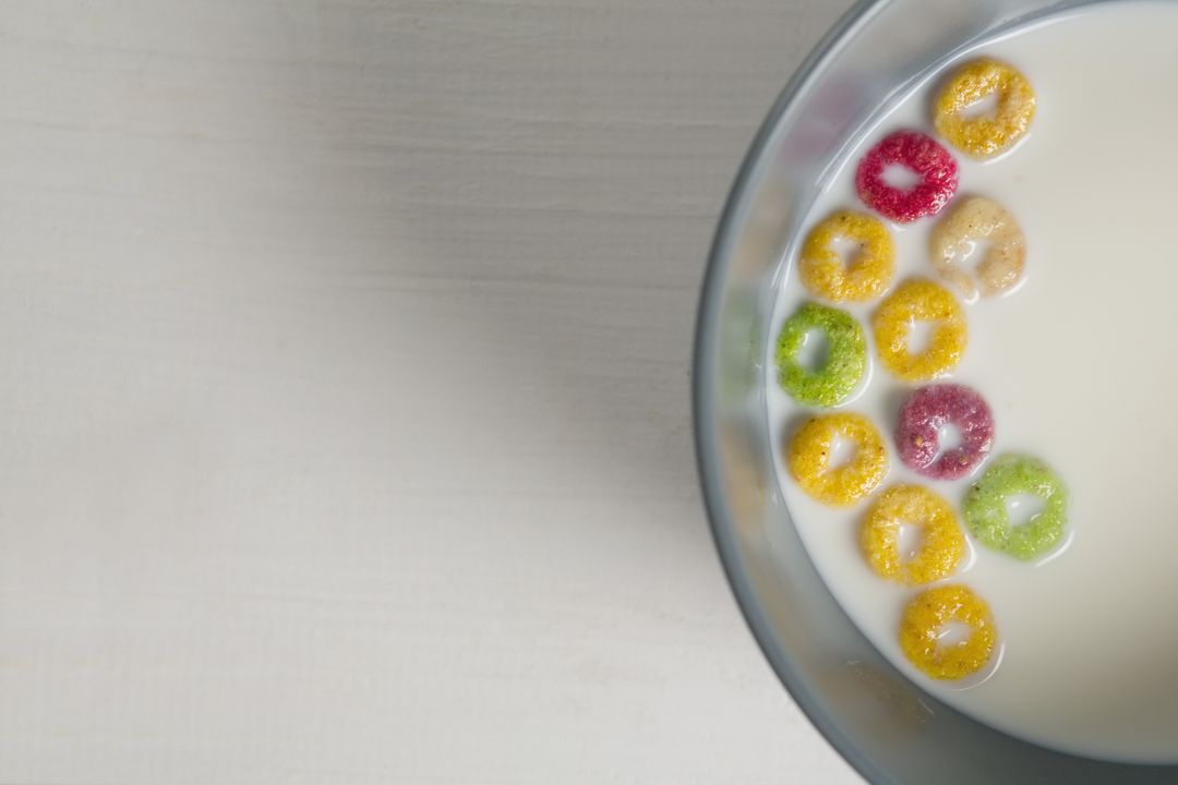 Overhead of milk bowl and cereal rings on white background Free Stock Images from PikWizard