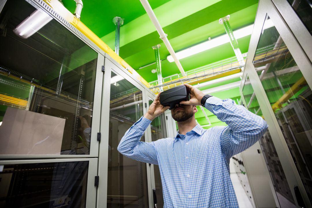 Technician using virtual reality headset in server room Free Stock Images from PikWizard